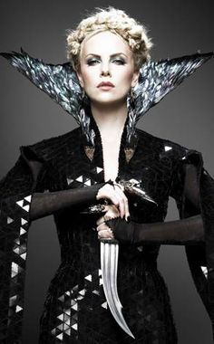 charlize as evil queen in snow white and the huntsman. love her hair and makeup in this photo.