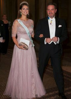 Princess Madeleine and Christopher O'Neill attend a dinner in honour of the 2014 Nobel prize Laureates at the Royal Palace in Stockholm.