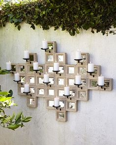 Wall-mounted candle sconce │Neiman Marcus http://www.luxurypools.com/blog/entryid/192/outdoor-room-accessories-pillows-curtains-rugs-wall-decor.aspx