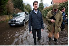 """WEBSITE """"Labour leader says UK is 'sleepwalking to a crisis over climate' as storms bring more major disruption and flooding. Britain is sleepwalking towards disaster because of a failure to recognise that climate change is causing the extreme weather that has blighted the country for more than a month, Ed Miliband has warned."""" Photograph: Graeme Robertson for the Observer"""