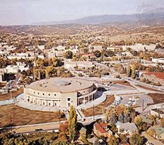 """The New Mexico State Capitol, located in Santa Fe, New Mexico, is the house of government of the U.S. state of New Mexico. It is the only round state capitol in the United States, and is known informally as """"the Roundhouse"""". The building was designed to resemble the Zia Sun Symbol"""