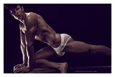 Eian Scully is the latest model to be shot by Daniel Jaems for his Obsession Series. The Canadian model (who spends most of his professional life in underwear) shows off his flexibility and talent for Yoga as he cavorts in front of the camera... Eian wears underwear from D.HEDRAL, Charlie By Matthew Zink, Todd Sandfield