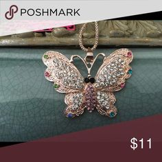Betsey Johnson Rhinestone Butterfly Necklace Brand new with tag! Gorgeous rose gold tone necklace with silver rhinestones accented with colored rhinestones! Betsey Johnson Jewelry Necklaces