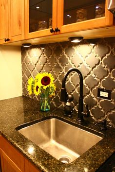 Quatrefoil backsplash!! The detail makes a statement with a solid color in order to coordinate with granite countertops.