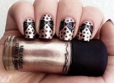 Golden Nail Art with Lovely Bows.