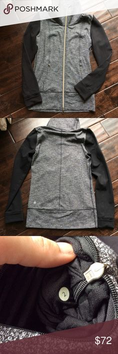 Lululemon jacket perfect condition Like new lululemon jacket.  Black sleeves with black and white body.  Two front zippers and roll up sleeves. lululemon athletica Jackets & Coats