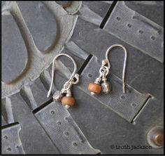 Orange Indonesian glass beads, Hilltribe silver and sterling silver ear wires. $18 truthjackson.com
