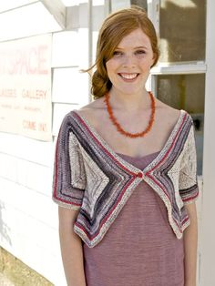 Cleverly pieced polygons are joined together to make a cropped cardigan with elbow-length sleeves, fastened with a single button.