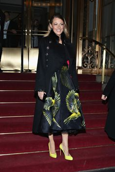 Blake Lively.. black halter top, Marchesa Spring 2015 skirt, Chanel Pre-Fall 2010 Coat, and Christian Louboutin Rolando Pumps.. #NYFW