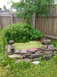 My water fountain in the back yard, made from a cast iron bath tub from our bathroom Reno love love love it.