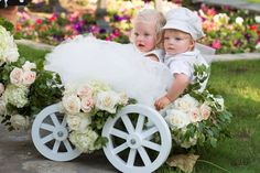 A young flower girl and ring bearer were pulled down the aisle in a white wagon adorned with greenery, ivory hydrangeas, and white roses with a hint of pink. Wagon For Wedding, Wedding Prep, Rustic Wedding, Wedding Bells, Tent Reception, Outdoor Ceremony, Wedding Reception, Wedding Photo Gallery, Wedding Photos
