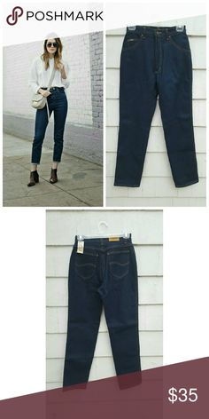 "Lee Dark Wash High Waisted Jeans NWT This is a pair of Lee jeans from the early 90's, NWT deadstock. Dark wash high waisted classic straight leg ! Tag states size 10P but ABSOLUTLY make sure you refer to ALL measurements before you purchase ! All measurements were taken while jeans laid flat on floor.  Waist 13"" Rise 12"" Hips 19"" Thigh 11"" Inseam 29.5"" Overall Length 40"". 65% cotton 35% polyester. Vintage Jeans Straight Leg"