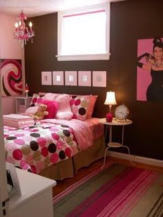 This is exactly what my old room looked like! Chocolate brown wall as accent, and bubblegum pink on all the other walls. Tan crown molding and bead board, and that exact same bead spread! So fun!!!
