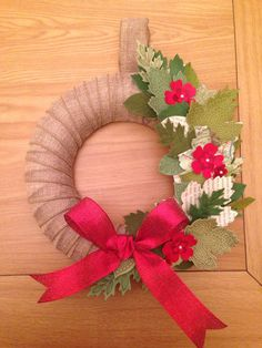 Christmas Wreath made with Stampin Up! Lighthearted Leaves stamp set on a burlap ribbon wrapped polystyrene wreath.                                                                                                                                                                                 More