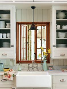 Love the details...Vintage Lowcountry House! Love the window, sink, light above the sink. Wish we could do marble counter tops but I am to afraid of them.  Do want my subway tiles somewhere but wonder if it would save money to do a high back splash and planks or bead board behind.