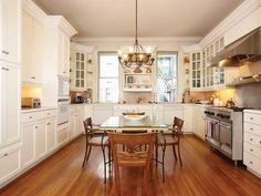White cabinets and wood floors.