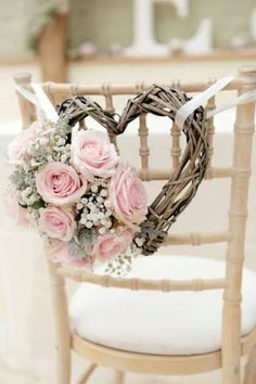 Vintage valentine inspiration - wicker heart chair decoration with pale pink roses and gypsophila