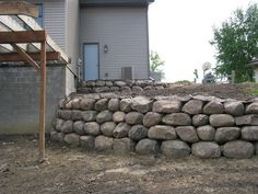 Boulder wall. Something like this, the boulders I get have a little more color variation