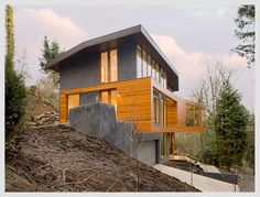 Like the garage approach, could be good for narrow lot  Modern Home - Skylab Design