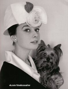 Audrey Hepburn photographed with Mr. Famous by Cecil Beaton at her house in Switzerland, in January 1960.