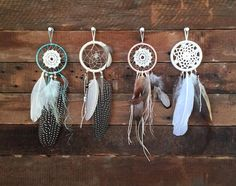 {Item Description}  Dimension: 2 1/2 hoop, 8 length Doily: white Feathers: spotted pheasant, white Beads: pearl (iridescent), sea glass Thread: neutral,