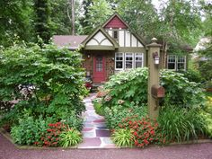 Mistake: Not considering architectural style when choosing plants.Solution: When selecting plants, you should match the architecture of your home with the theme of your garden. Above, the cottage-style garden goes very well with the style of the home. Besides the plants in your garden, you need to think about your hardscape. If you are putting in a deck, for example, you need to make sure those elements of your garden also reflect positively upon your house.