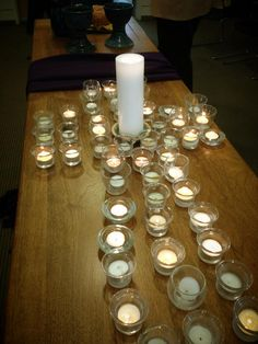 Prayers of the people around a prayer/ candle cross