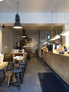 High-bay cans and hanging fluros over the counter at this Berlin cafe…rustic vibes