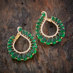 Its a lovely green fashion earing with white and green stone combination  www.shopzters.com