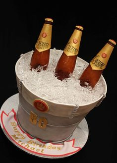 Beer Ice Bucket Cake. Three types of cake make up this cake. The first layer is Red velvet with citrus cream cheese filling , the second layer is vanilla sponge with fresh strawberry and vanilla cream filling and the third layer is chocolate mud cake with orange zest and chocolate vanilla fresh cream filling. The beer bottles are made from isomalt.