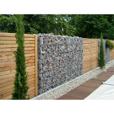 Gabion and wood fence