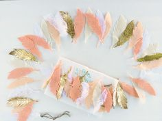 Feather Garland from The Lil Felt Shop on Etsy - perfect accent in a tribal-inspired nursery!