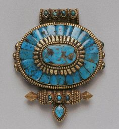 Ga'u hair ornament (takor) Lhasa, Tibet mid-20th century Turquoise set in gilt silver
