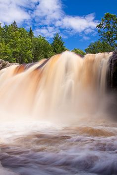 Black River rushing over Little Manitou Falls after several inches of rain fell the day before. Pattison State Park, Wisconsin.  Photo: Jerry Mercier via Flickr