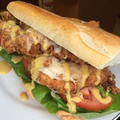 Fried Chicken Hoagies with PepperJack Cheese, Honey Mustard, Lettuce, Tomatoes, Spicy Mayo on a Toasted Hoagie Roll.