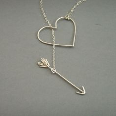 Heart and arrow necklace via Etsy.
