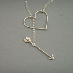 Heart and arrow necklace via Etsy.