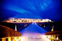 wedding tent on lake michigan destination wedding brigt blue sky and white lights by Chelsea Elizabeth Photography