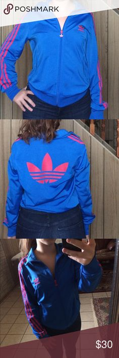 Blue & Pink Adidas Track Sweater This adidas sweater is in perfect condition. I've owned it for a while and it's just been stuck in the back of my closet. #adidas #tracksuit #sweater #blue #pink adidas Tops Sweatshirts & Hoodies