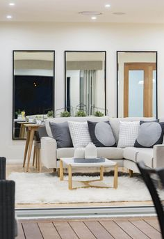 A sneak peek of the #lounge from the #alfresco of the Stoneleigh on display in Moncrieff, featuring a #Scandinavian #interior #style. For details and more photos see http://mcdonaldjoneshomes.com.au/display-home-locations/moncrieff. #scandi #furniture #interiordesign #interiorstyle #décor #decorate #home #newhome #lounge #living #coffeetable #mirror #mirrors #loungesuit #rug #grey #blue #neutral #timber #wood #verandah #outdoors #indoors