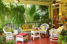 Beautiful relaxing veranda space, surrounded in a garden oasis  ~ love white wicker furniture