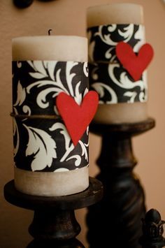 Pillar candles wrapped w scrapbook paper & a ribbon---Maybe purple ribbon and lace????
