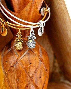 ALEX AND ANI Pineapple Charm Bangle | Welcome. Friendship. Warmth | Expressing a sense of welcome and good cheer, the pineapple signifies hospitality. New England sea captains traditionally placed a pineapple outside their homes as a symbol of a safe return. Home and hospitality warmly embrace friends. Genuine welcome makes lasting connections.