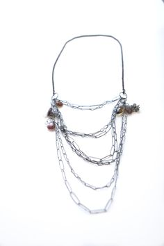 Oxidized sterling silver chain necklace by Karen Gilbert, with garnet, labradorite and tourmaline. Gallery Lulo.