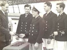 Captain Robert Sydney Hutchinson being presented with silver oar as cox of 1937 HMS Conway rowing team.