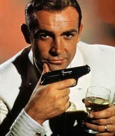 Sean Connery as James Bond. Curious why he has on a wedding ring...the only Bond that ever married was Bond No. 2 George Lazenby. Could be he didn't remove his actual real life wedding ring for this photo. Mmmmmm