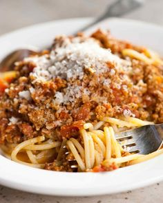Martha's traditional Bolognese sauce recipe calls for half ground pork and half ground beef. It's not as heavily based on tomatoes as typical Italian-American meat sauces, in fact the meat is cooked with white wine, milk, and chicken stock in addition to tomatoes.