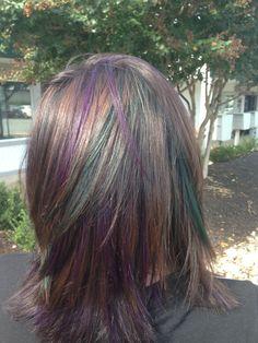 Brown hair with purple and green peekaboo highlights