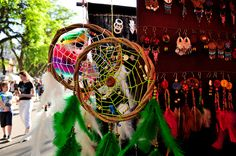 Colorful dreamcatchers and jewelry at a market.