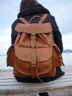 Leather Backpack - Leather Rucksack - Mens Leather backpack - Womens backpack - one pocket leather backpack, LARGE size, knapsack   This model is our Large backpack it is made of stunning 100% full grain leather. It has two small side pockets and a front pocket which are all closed with real buckles. The bag has a handle and two leather straps which are adjustable and detachable. This Backpack is big enough and it can carry a laptop plus many other things!! • Material:100% Full Grain leather…